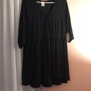 Tunic with cross neck and tassels